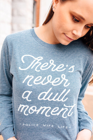 There's Never A Dull Moment Police Wife Life © L/S Unisex Top (White)