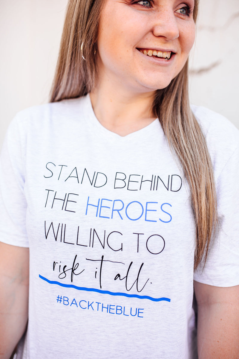 Stand Behind The Heroes Willing To Risk It All© Unisex Tee (Thin Blue Line)