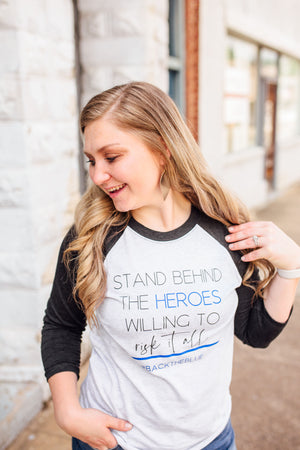 Stand Behind The Heroes Willing To Risk It All © Unisex Baseball Raglan (Black + Royal Blue)