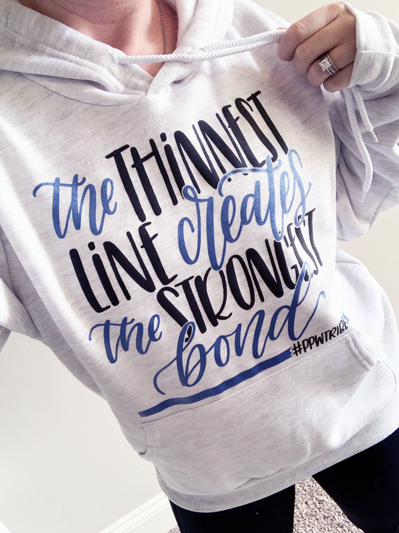 The Thinnest Line Creates The Strongest Bond © Unisex Pullover Hoodie (Black + Blue Shimmer)