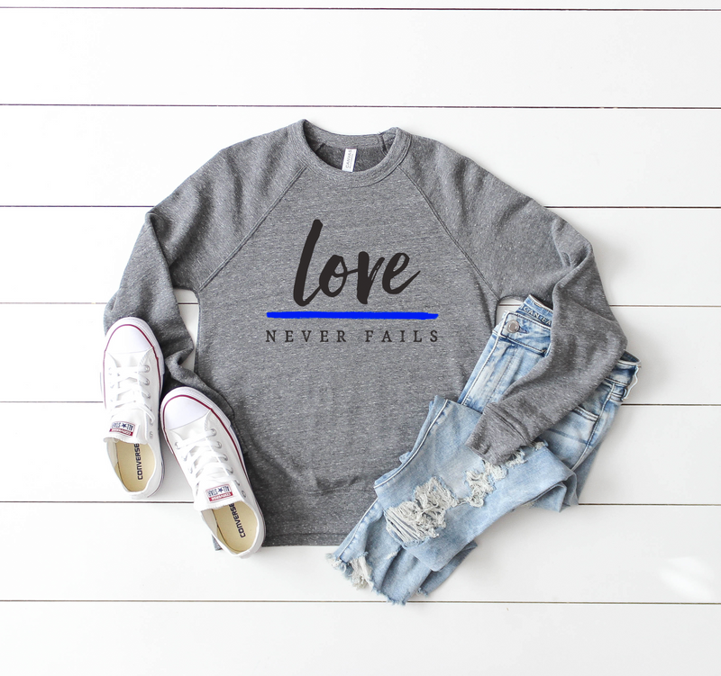 Love Never Fails Unisex Crewneck Sweatshirt (TBL)