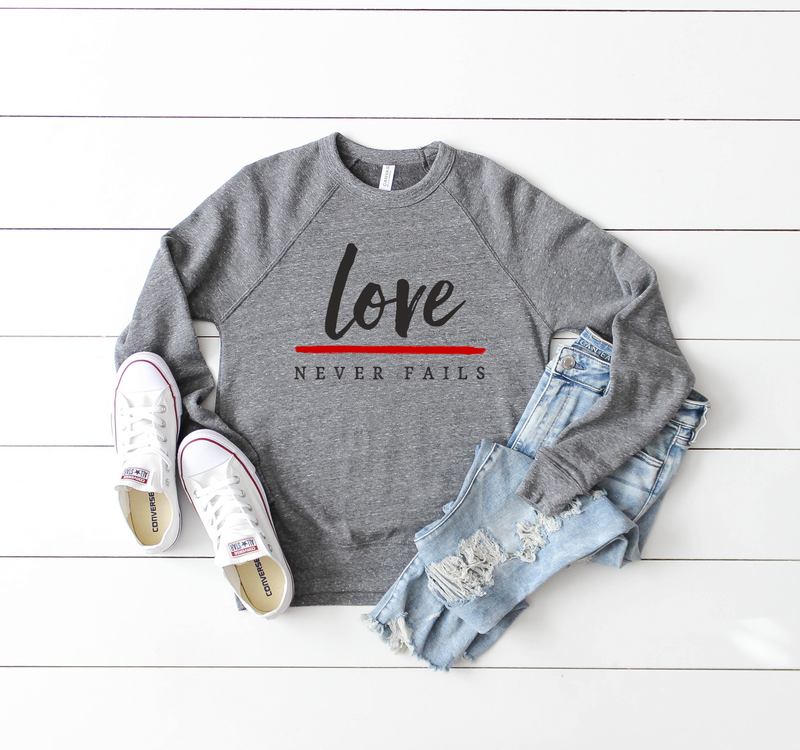 Love Never Fails Unisex Crewneck Sweatshirt (Thin Red Line)