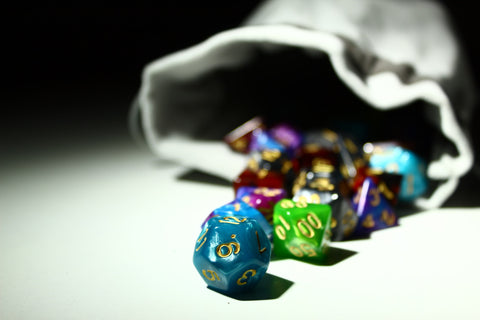 dnd dice spilling out of a small bag. image by @armato on unsplash