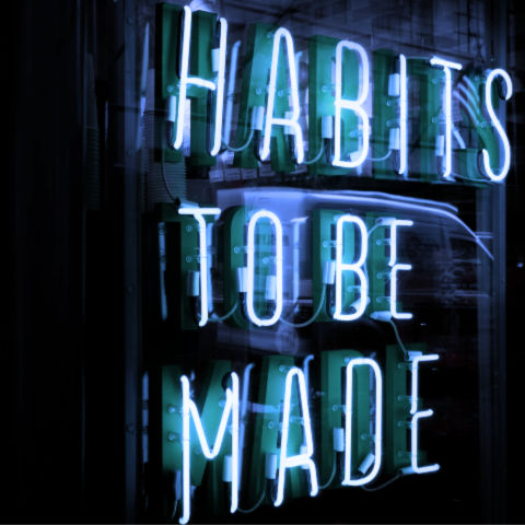 "neon sign that says ""habits to be made"""
