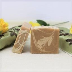 By the Sea Soap Shoppe Great Goat Soap is light brown with a random lighter pattern throughout. As the name says, it is made with goat milk which brings all its benefits for your skin. It comes with a delightful Oatmeal, Milk and Honey fragrance. $7.00 each.