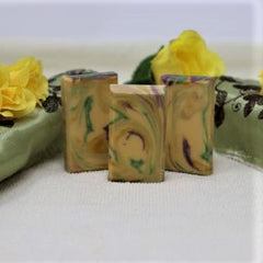By the Sea Soap Shoppe African Garden soap. The bar has swirls of colors of yellow, purple and green. All natural ingredients and handmade. Cost is $3.00.
