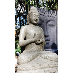 Volcanic rock Budha Blessing statue.