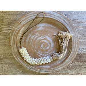 Shell garlands in cowrie or white snail shell.
