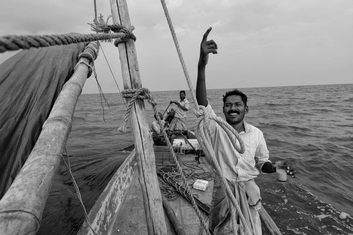 "Fisherman calls out to a passing boat, ""wanna come over for tea."" 