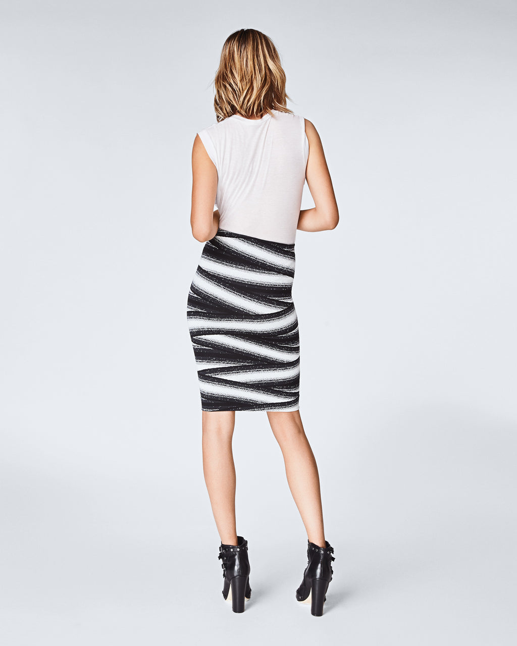 BA10142 - BANDAGE STRIPE SKIRT - bottoms - skirts - With contrasting black and white bandage stripes, this form fitting skirt is perfect for year round wear. The comfortable and figure hugging fabric make this knee-length skirt easy to wear. Finishedwith a concealed zipper for closure and unlined.