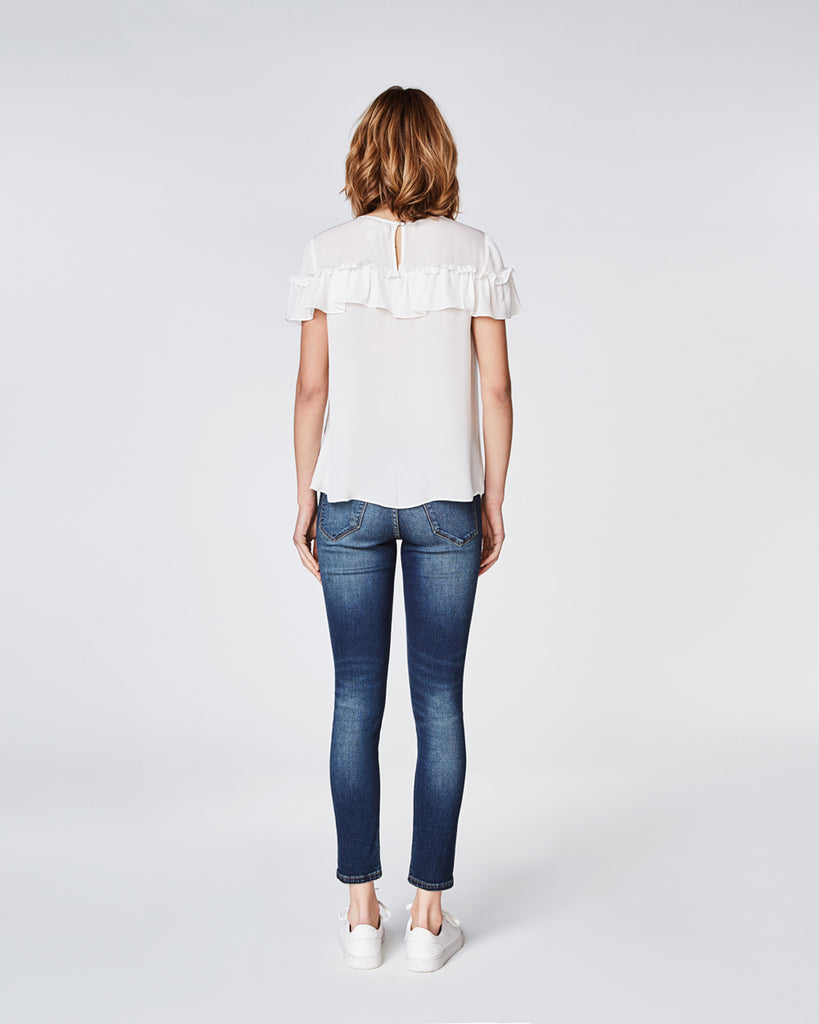 BD10246 - SILK RUFFLE TOP - tops - shirts - In a lightweight silk, this top features a statement ruffle for a trendy vibe. The versatile silhouette is perfect for pairing with jeans or a skirt for an effortlessly cool look. Finished with a keyhole and button for closure. Alternate View