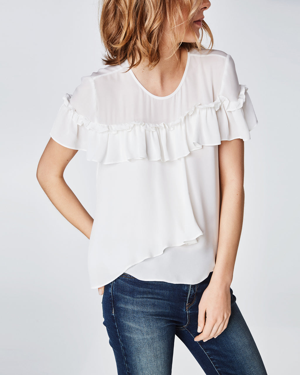 BD10246 - SILK RUFFLE TOP - tops - shirts - In a lightweight silk, this top features a statement ruffle for a trendy vibe. The versatile silhouette is perfect for pairing with jeans or a skirt for an effortlessly cool look. Finished with a keyhole and button for closure.