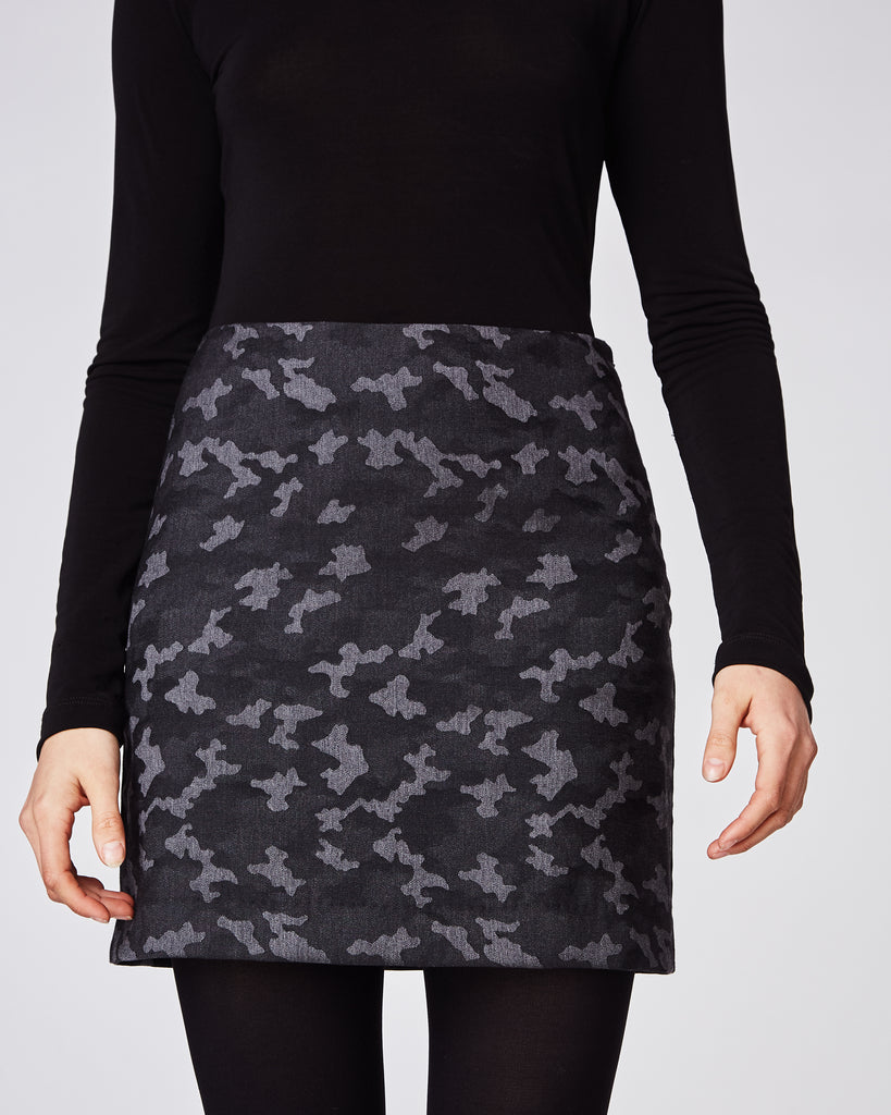 BD10251 - CAMO MINI SKIRT - bottoms - skirts - In a dark camo, this fitted mini skirt fall mid thigh and features a concealed zipper for closure.Wear with tights throughout the winter. Fully lined. Alternate View