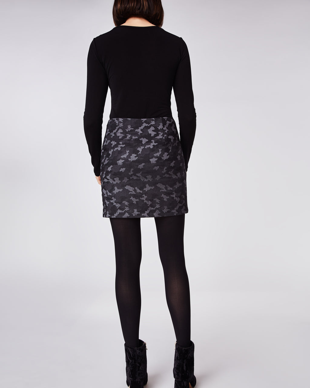 BD10251 - CAMO MINI SKIRT - bottoms - skirts - In a dark camo, this fitted mini skirt fall mid thigh and features a concealed zipper for closure.Wear with tights throughout the winter. Fully lined.