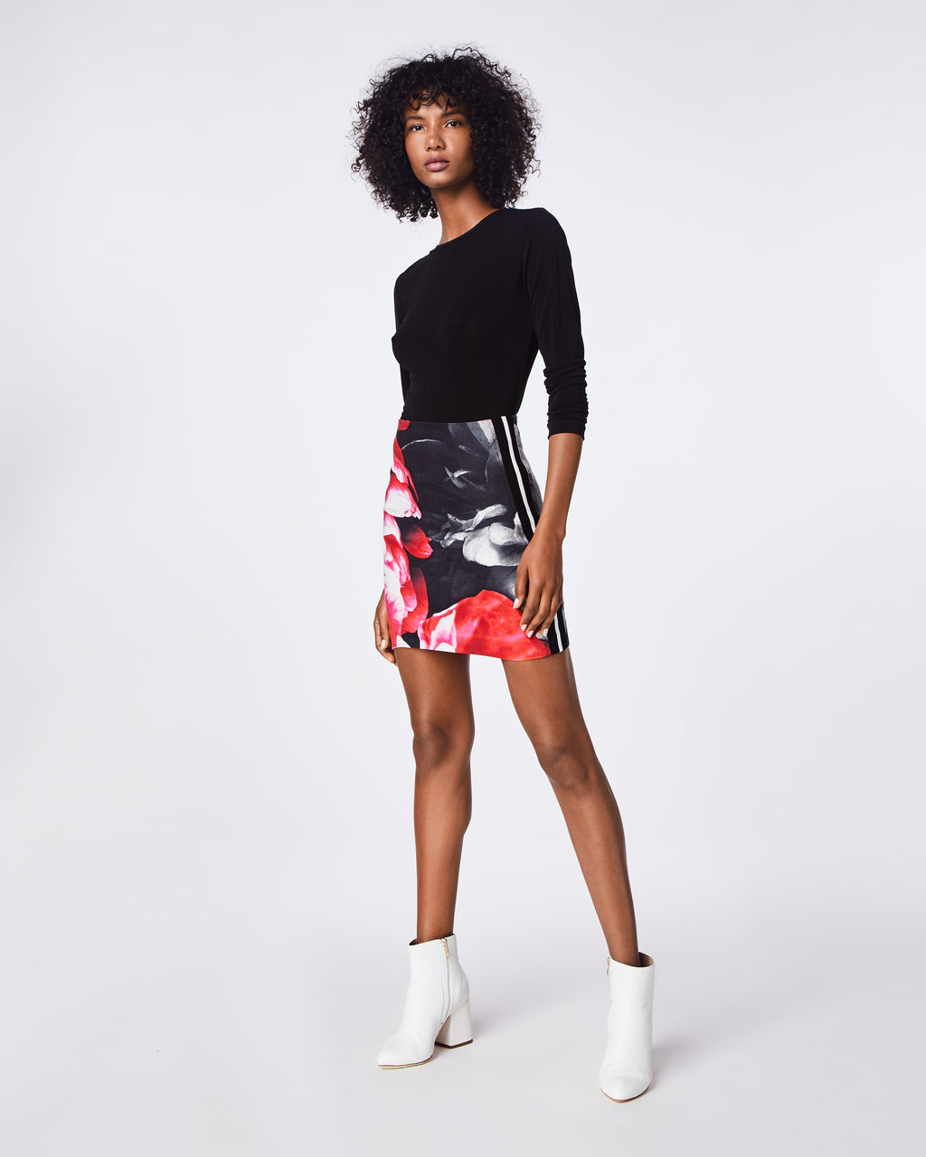 BD10260 - GIANT GARDEN MINI SKIRT - bottoms - skirts - A SPORTS-LUXE LOOK - THIS MINI SKIRT'S FLORAL PRINT AND STRIPED SIDE DETAIL MAKES IT A GO TO STYLE.