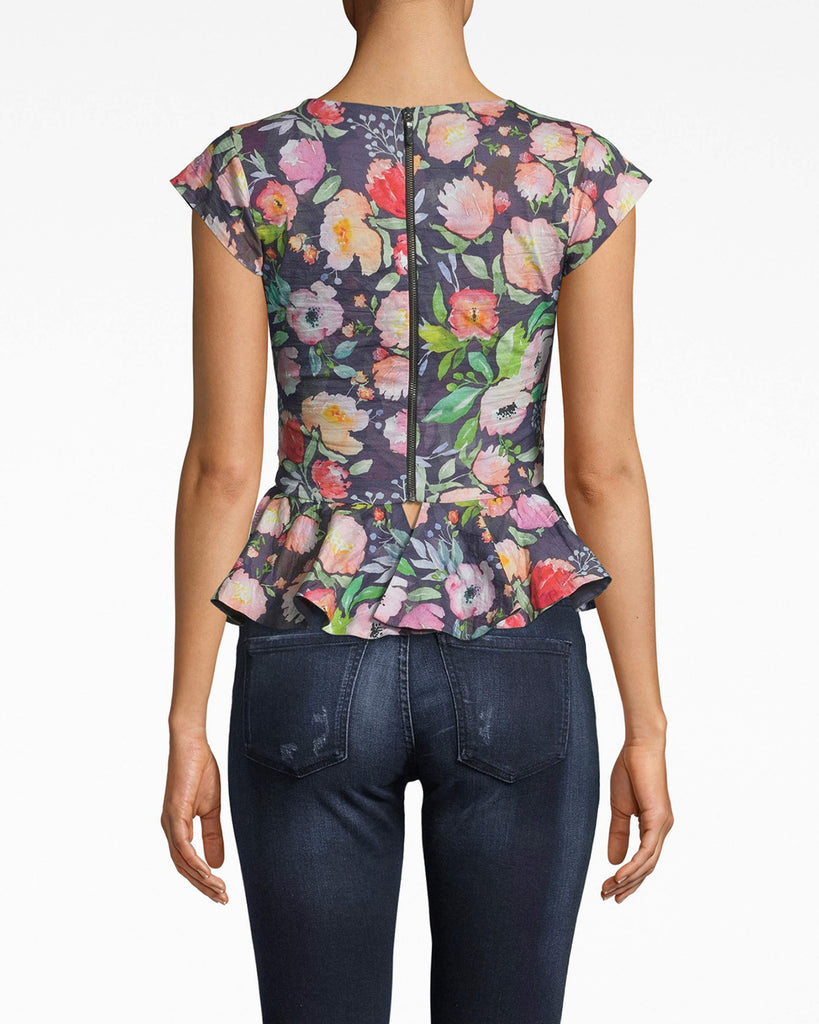 BD20114 - WATERCOLOR FLORAL COTTON METAL PEPLUM TOP - tops - shirts - THIS TOP IS BEYOND FLATTERING. FITTED WITH A PEPLUM FLARE, THIS PIECE HUGS ALL THE RIGHT PLACES. MADE FROM OUR SIGNATURE COTTON METAL, THE SLIGHT SHIMMER PAIRED WITH THE FLORAL PATTERN MAKES IT ALL THE MORE EYE CATCHING. Alternate View