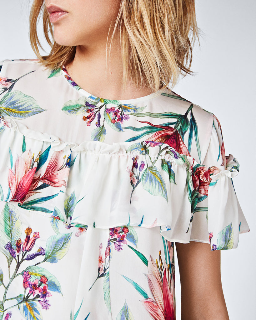 BF10326 - TROPICALE RUFFLE TOP - tops - shirts - In a crisp white, this floral silk top has a rounded neckline and ruffle accent creates for a feminine vibe. Finished with a back keyhole closure and unlined. FINAL SALE Alternate View