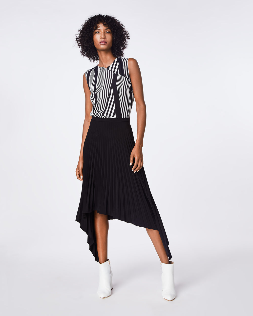 BF10360 - PLEATED SKIRT - bottoms - skirts - ASYMMETRICALLY CUT, OUR PLEATED SKIRT HITS AT THE WAISTLINE HAS A FLOWY FIT. IT HAS A 1 INCH WAISTBAND AND A CONCEALED ZIPPER WITH A HOOK AND EYE.