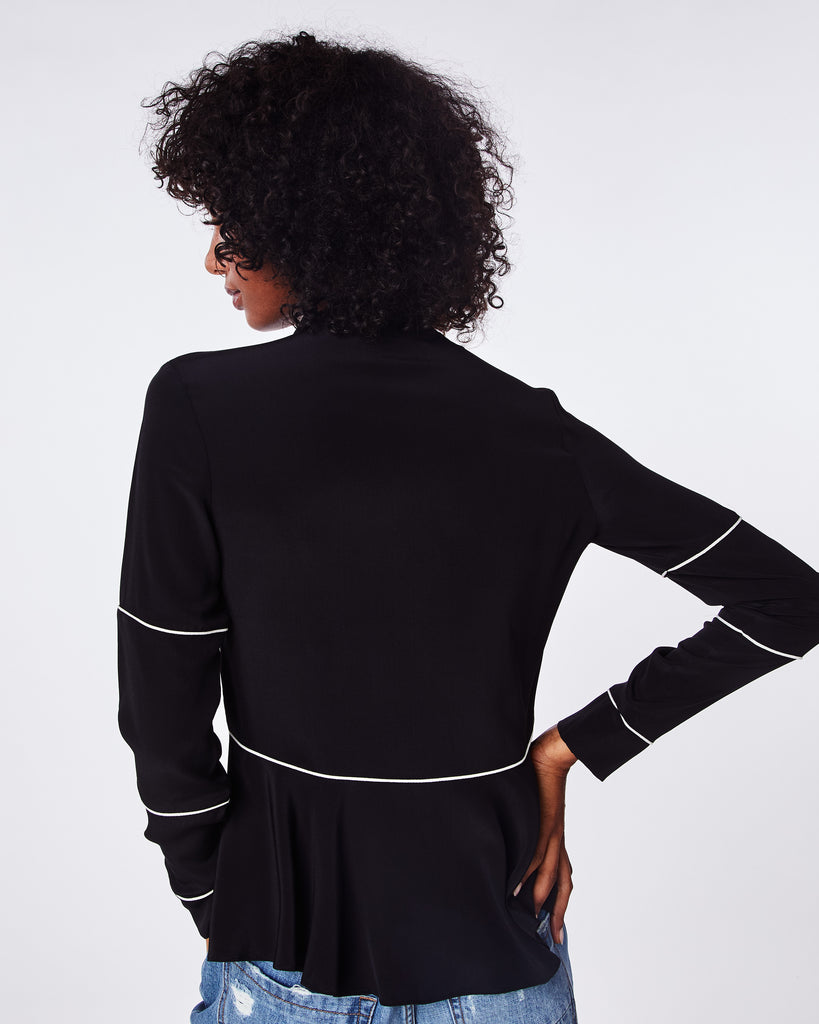 BF10363 - SOLID SILK BLEND PIPED TIE BLOUSE - tops - blouses - The feminine drapey tie neck on this long sleeve blouse is contrasted with modern white piping. The hem is almost skirt-like, flowing outwards in pleats. Alternate View