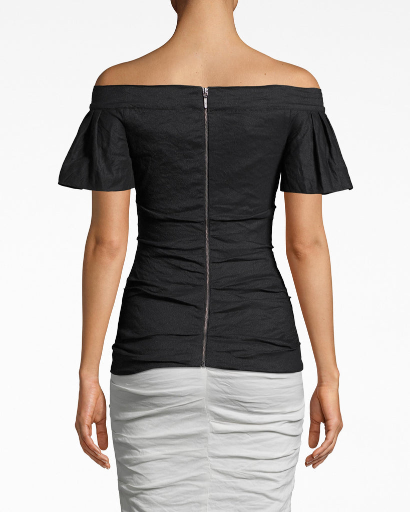 BF10399 - SOLID COTTON METAL OFF THE SHOULDER TOP - tops - shirts - DESIGNED IN OUR ICONIC COTTON METAL, THIS FITTED OFF THE SHOULDER TOP IS A CLOSET STAPLE THAT WILL BE ON REPEAT ALL SPRING LONG. FEATURING 3/4 FLARED SLEEVES AND A FLATTERING RUCHED BODY. FULLY LINE D AND EXPOSED BACK ZIPPER FOR CLOSURE. Alternate View