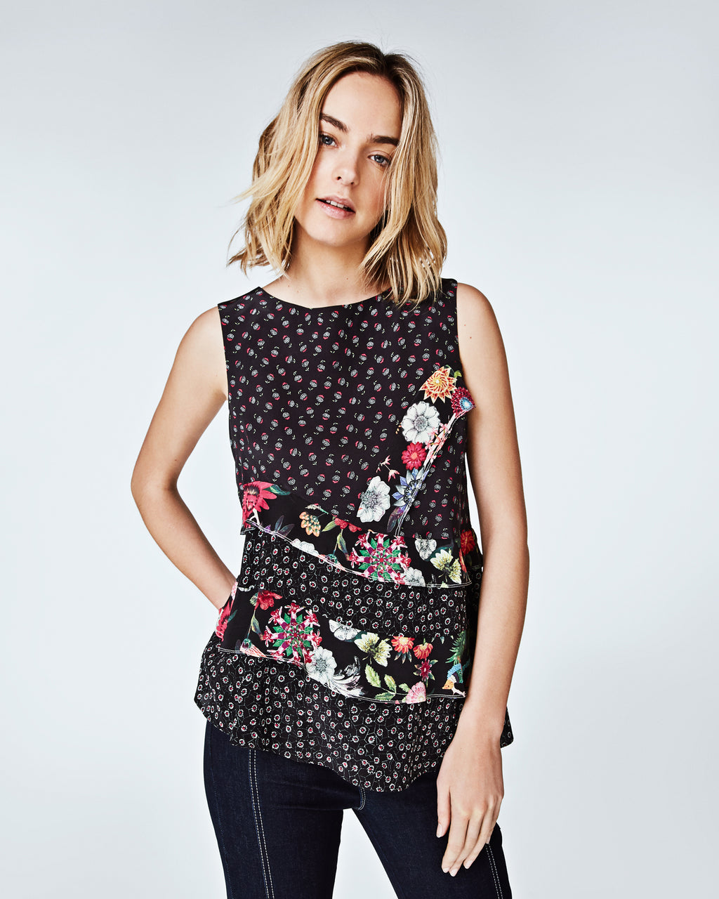 BG10294 - DITZY DANDELION BOAT NECK TOP - tops - blouses - This silk tank features contrasting floral prints and asymmetrical ruffles for a subtle edge on a feminine vibe. With a boat neckline, this top can be worn with a blazer for a more sophisticated look, or paired with jeans and sneakers for a street style take. Finished with a back concealed zipper for closure and unlined.