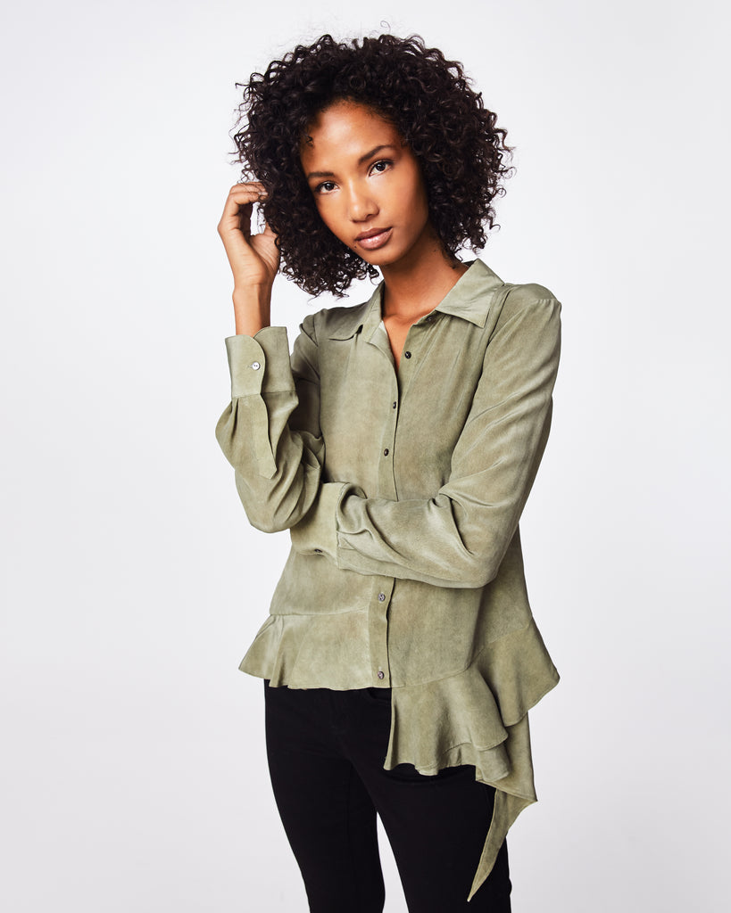 BG10304 - STONE WASH CDC ASYMM BUTTON DOWN SHIRT - tops - blouses - In a stone wash silk, this blouse features an asymmetrical hemline with ruffle details. Perfectly paired with denim or dressed up with a tailored skirt. Finished with front buttons for closure and unlined. Final Sale Alternate View