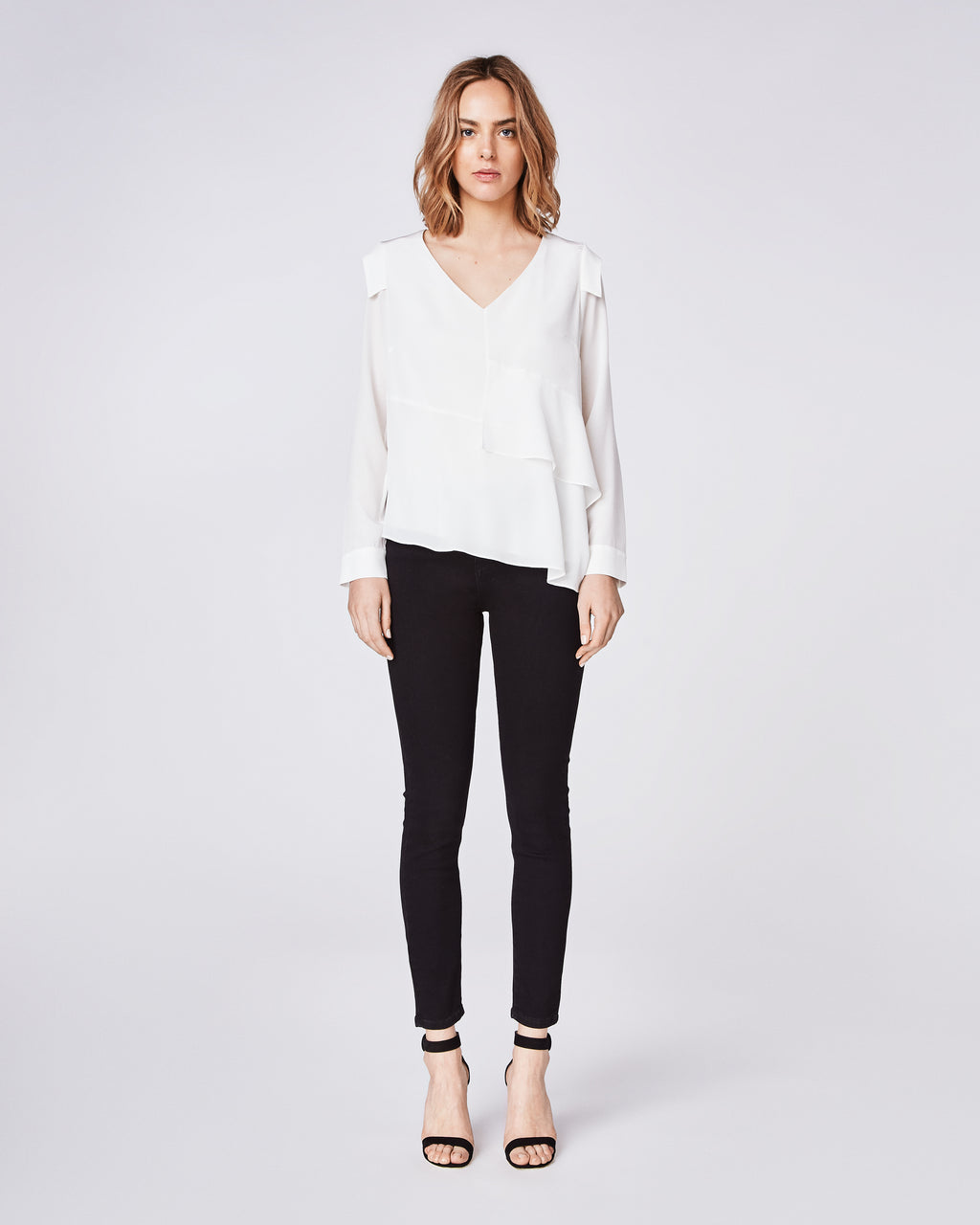 BG10307 - SILK ASYMMETRICAL TOP - tops - blouses - Wheather your dressing for work or for the weekend, style this asymmetrical, silk top with denim and a stacked heel or sneaker. Front lined only.