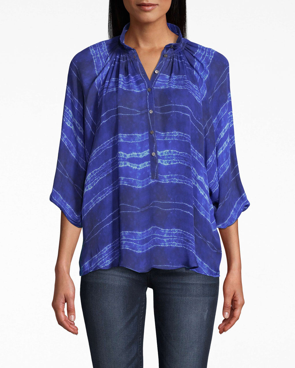 BG10343 - SHIBORI STRIPE SMOCKED COLLAR BLOUSE - tops - blouses - THIS RELAXED SILHOUETTE HAS SUBTLE BUTTONS UP THE FRONT AND A DELICATELY PLEATED COLLAR. OUR SHIBORI STRIPE PRINT UPGRADES THIS CLASSIC TO A STATEMENT PIECE. Add 1 line break STYLIST TIP: STYLE WITH WHITE JEANS AND CHUNKY GOLD HOOPS.