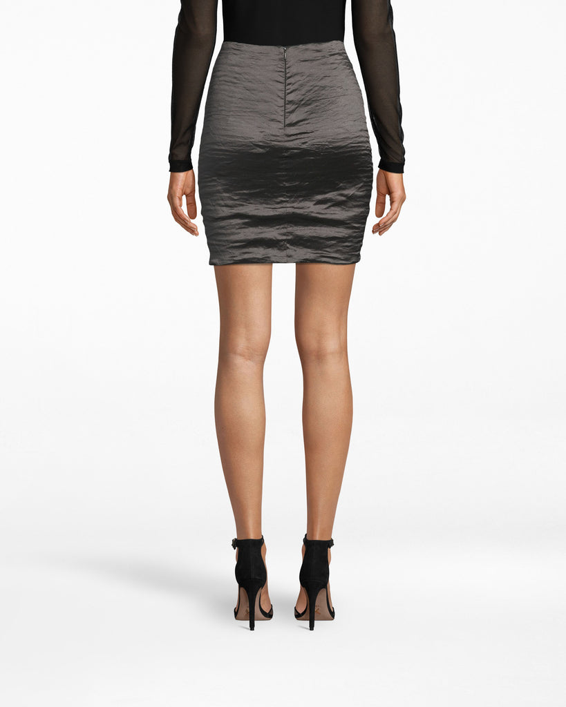 "BH10007 - TECHNO METAL MINI SKIRT - bottoms - skirts - Kick it. Our Techno Metal Mini Skirt features the signature textured, ""shiny"" appearance that makes it look so elegant. The back zipper is exposed and the hem falls above the knee. Alternate View"