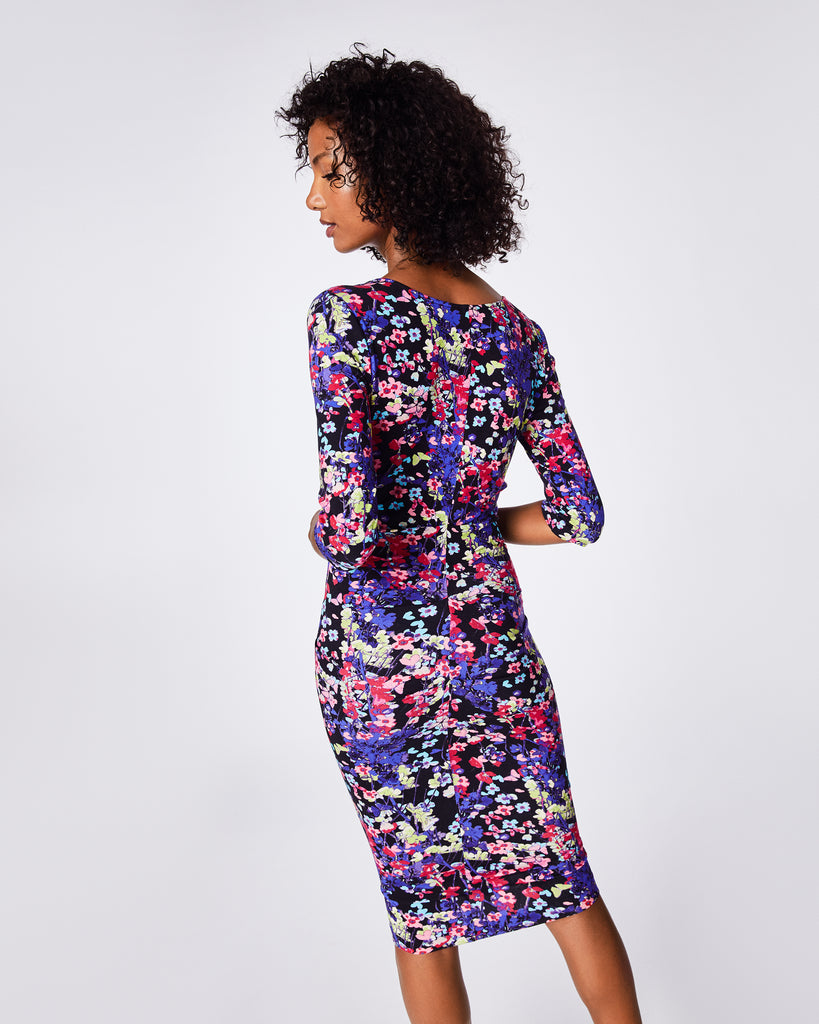 BH10395 - Hanging Flowers Sleeve Tuck Dress - dresses - midi - This skinny wrap dress has tuck details through the hips for a flattering fit. The 3/4-length sleeve and deep v-neck adds a sophisticated look. Finished with a concealed zipper for closure. Knee-length Alternate View
