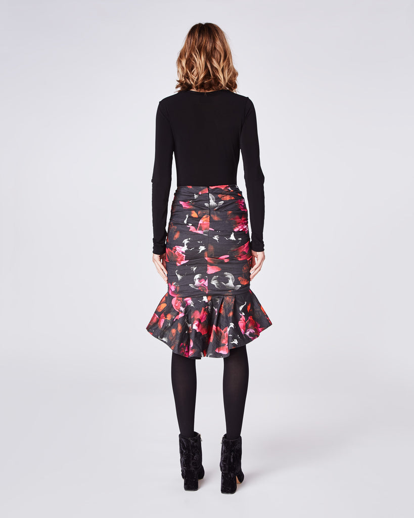 BH10418 - FRAGMENT FLORAL RUFFLE HEM SKIRT - bottoms - skirts - This floral fitted skirt that features a ruffled hemline. Falling mid thigh, this skirt is finished with a concealed zipper for closure and unlined. Alternate View