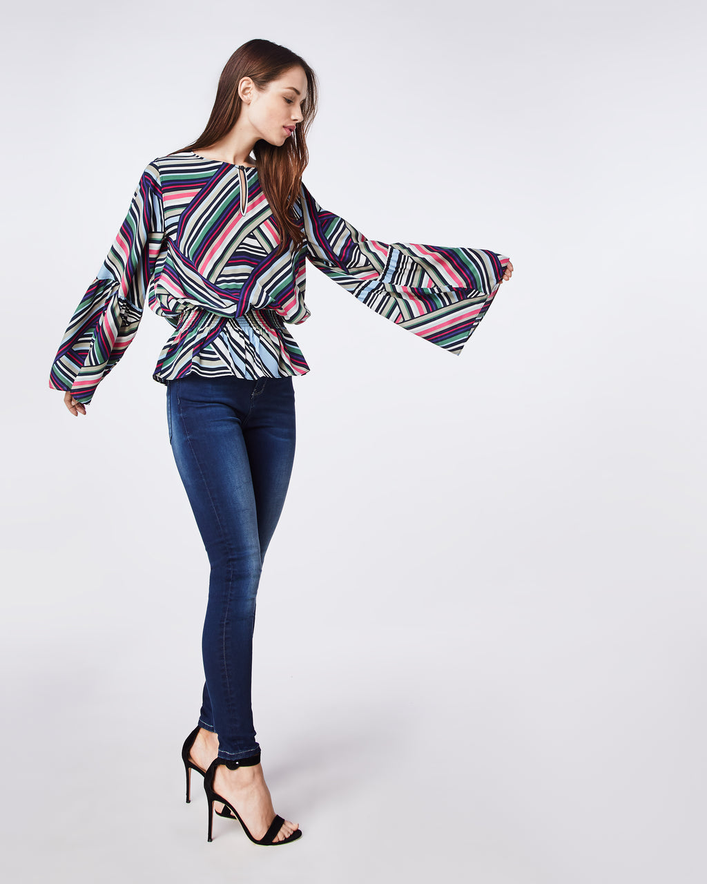 BH10437 - ABSTRACT STRIPE BELL SLEEVE TOP - tops - blouses - This top is a party in itself with bell sleeves that start fitted at the shoulder. The waistband is elastic making it both comfortable and easy. Pair back with your favorite denim.