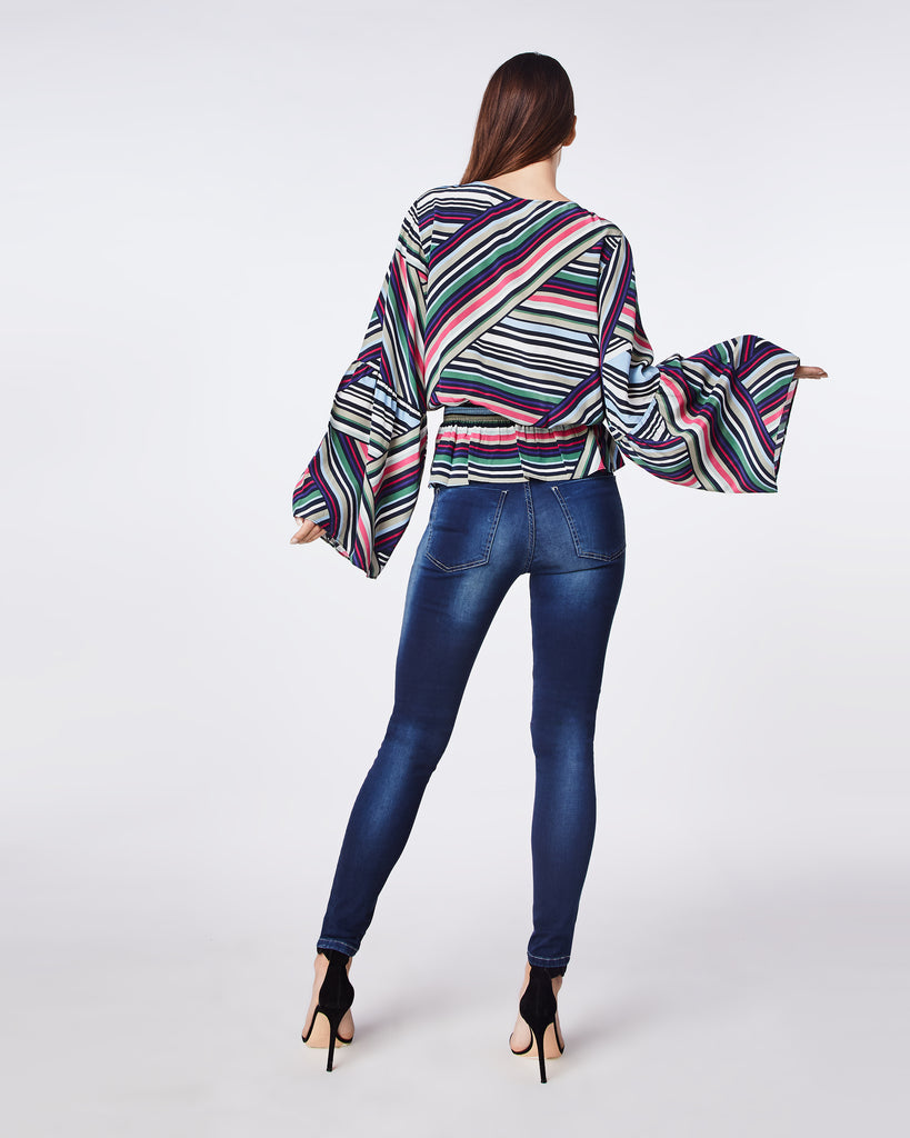 BH10437 - ABSTRACT STRIPE BELL SLEEVE TOP - tops - blouses - This top is a party in itself with bell sleeves that start fitted at the shoulder. The waistband is elastic making it both comfortable and easy. Pair back with your favorite denim. Alternate View