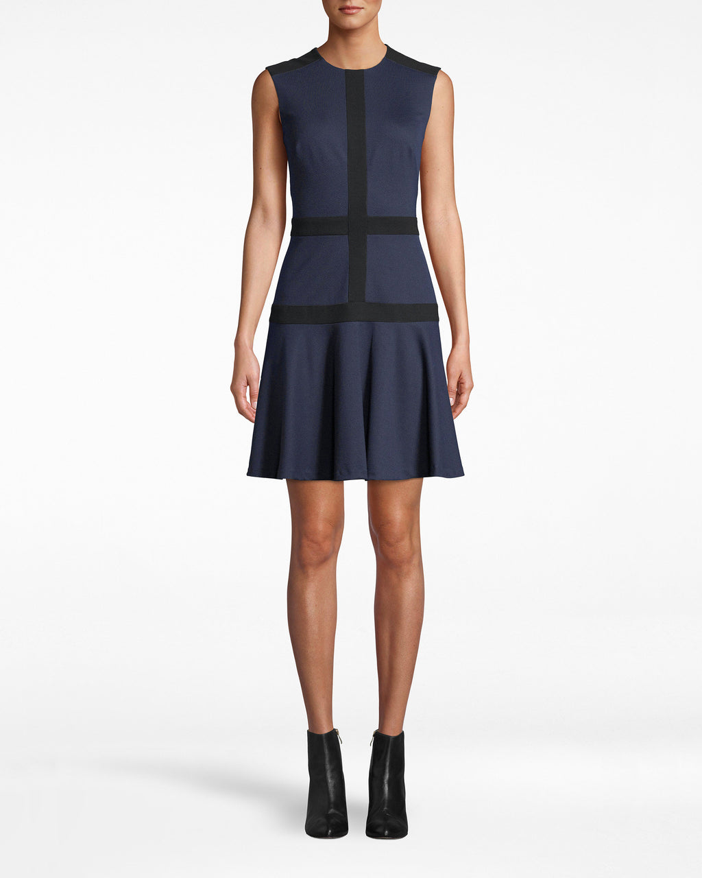 BH10492 - PONTE FLARE DRESS - dresses - short - Structured chic. This Ponte Flare Dress balances its navy hue with symmetrical black fabric work. The hem pleats outwards for an extra feminine touch. Exposed back zipper for closure.