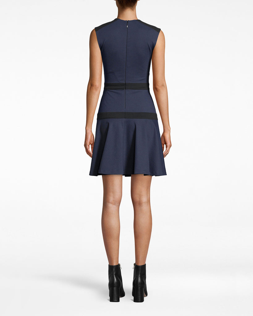 BH10492 - PONTE FLARE DRESS - dresses - short - Structured chic. This Ponte Flare Dress balances its navy hue with symmetrical black fabric work. The hem pleats outwards for an extra feminine touch. Exposed back zipper for closure. Alternate View