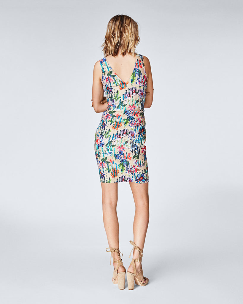BJ10159 - TROPIC SPLIT KEENA DRESS - dresses - short - In our Tropic Split print, this v-neck dress falls above the knee for a feminine and sophisticated silhouette. Skillful side tucks create a figure flattering form. Finished with a concealed zipper for closure and fully lined. Final Sale Alternate View