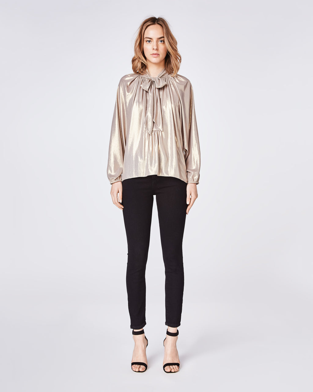 BK10269 - METALLIC FOIL TIE BLOUSE - tops - blouses - A feminine style, but add the gold metallic fabric on this long-sleeve blouse for a downtown vibe. This lightweight blouse features a neck bow tie at the neckline and a dolman style sleeve.