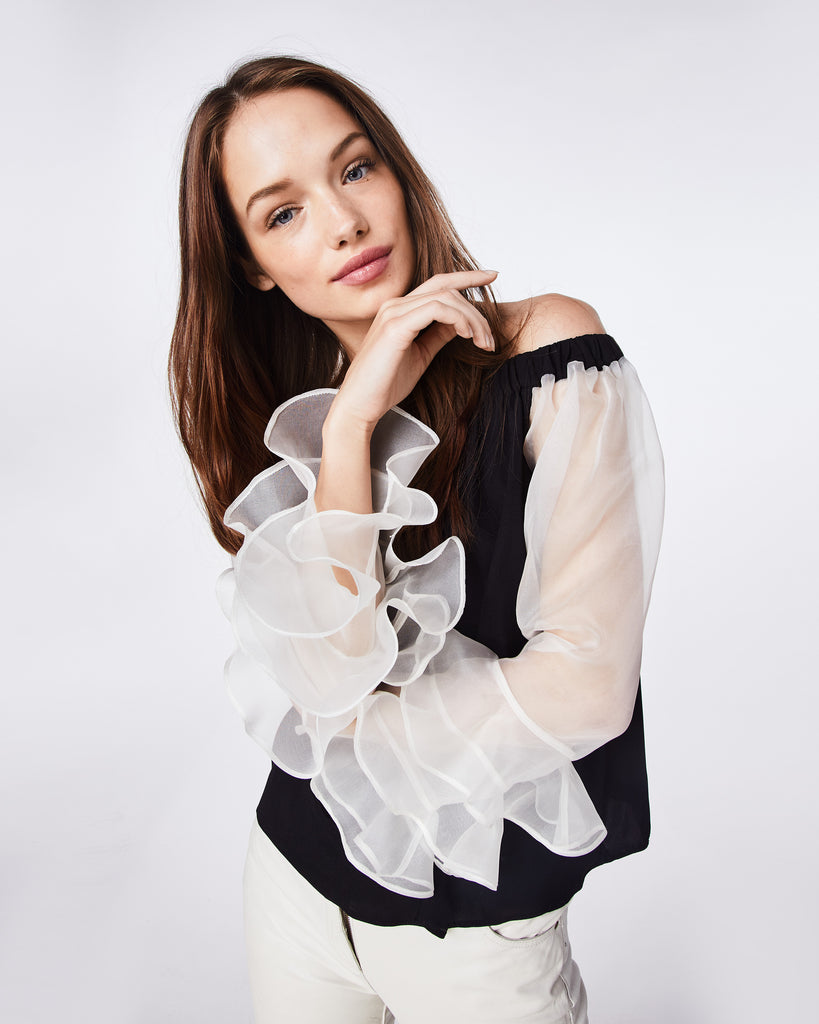 BK10277 - ORGANZA AND CHARMEUSE BLEND OFF THE SHOULDER TOP - tops - shirts - A FEMININE OFF THE SHOULDER TOP THAT FEATURES RUFFLE SLEEVES. IT HAS AN ELASTIC SHOULDER BAND FOR A COMFORTABLE, CHIC FIT. Alternate View