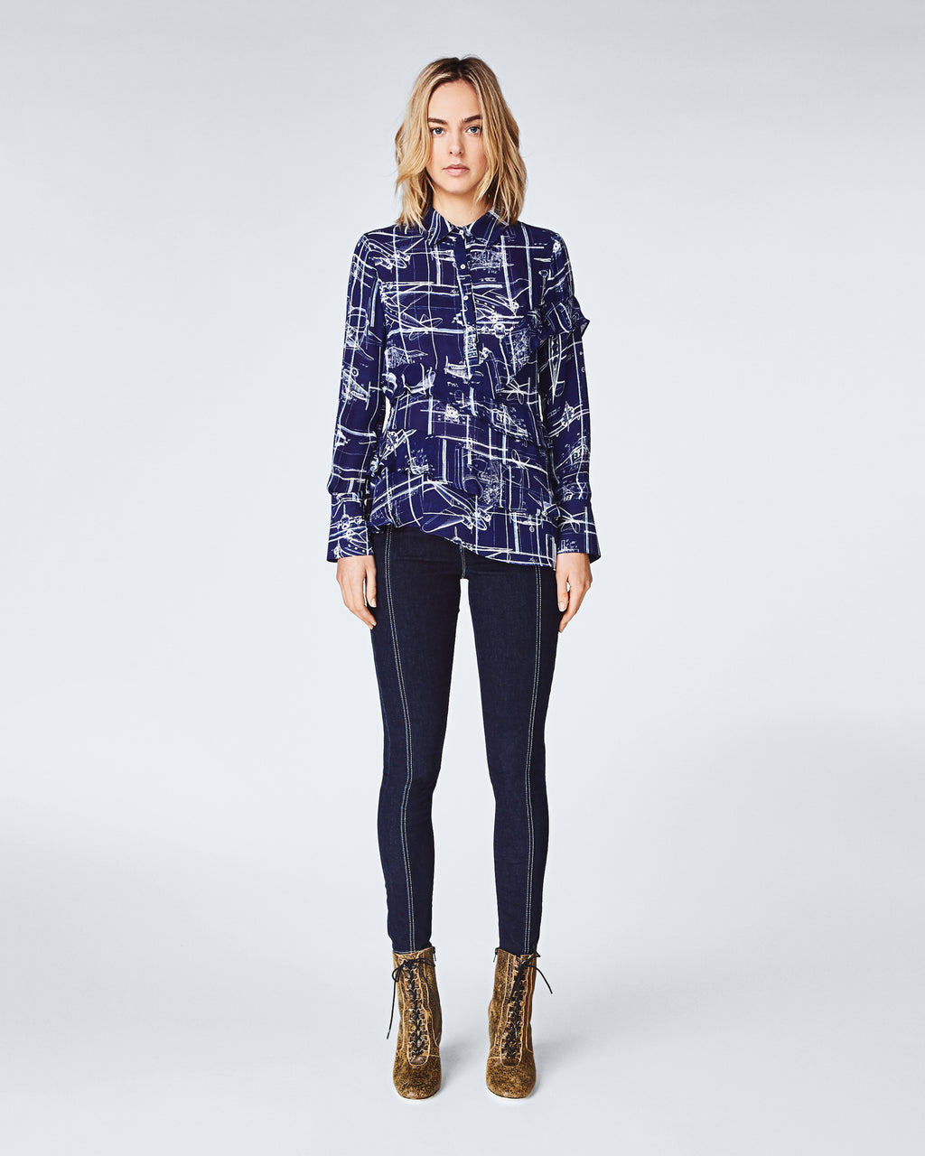 BL10143 - BLUEPRINT ASYMM BOYFRIEND BLOUSE - tops - blouses - The perfect statement stop, this boyfriend blouse features asymmetrical ruffles for an updated take on a classic. This printed top is finished with abuttons for closure and unlined.