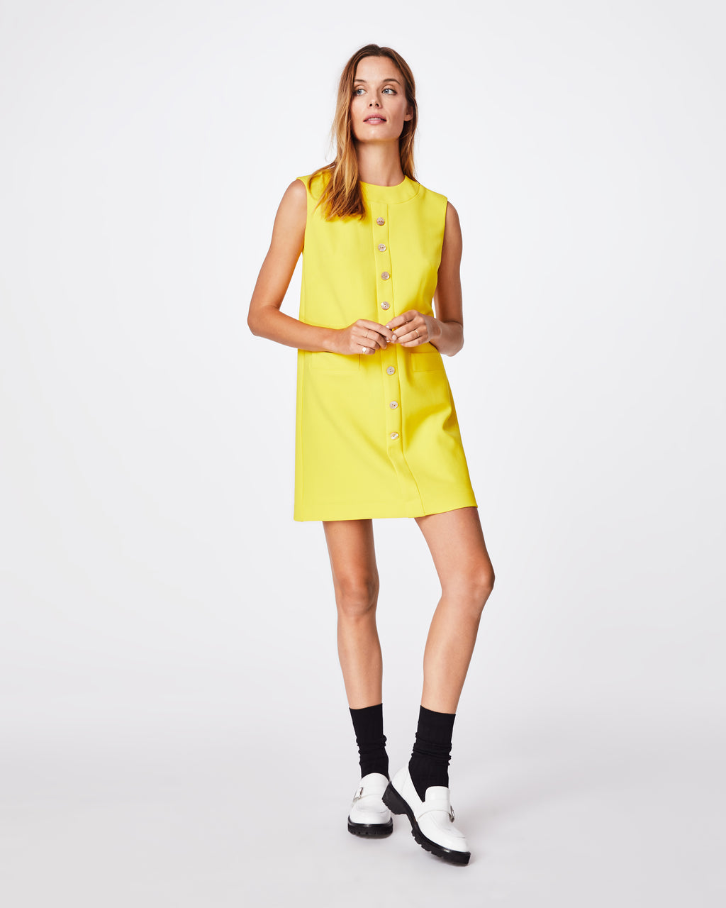 BM10211 - STRETCHY TECH MOD DRESS - dresses - midi - Miss Mod. This colorful midi dress has a simple, straight fit while showcasing button details down the middle. Retro sunglasses and high socks are required. Exposed back zipper, lined.