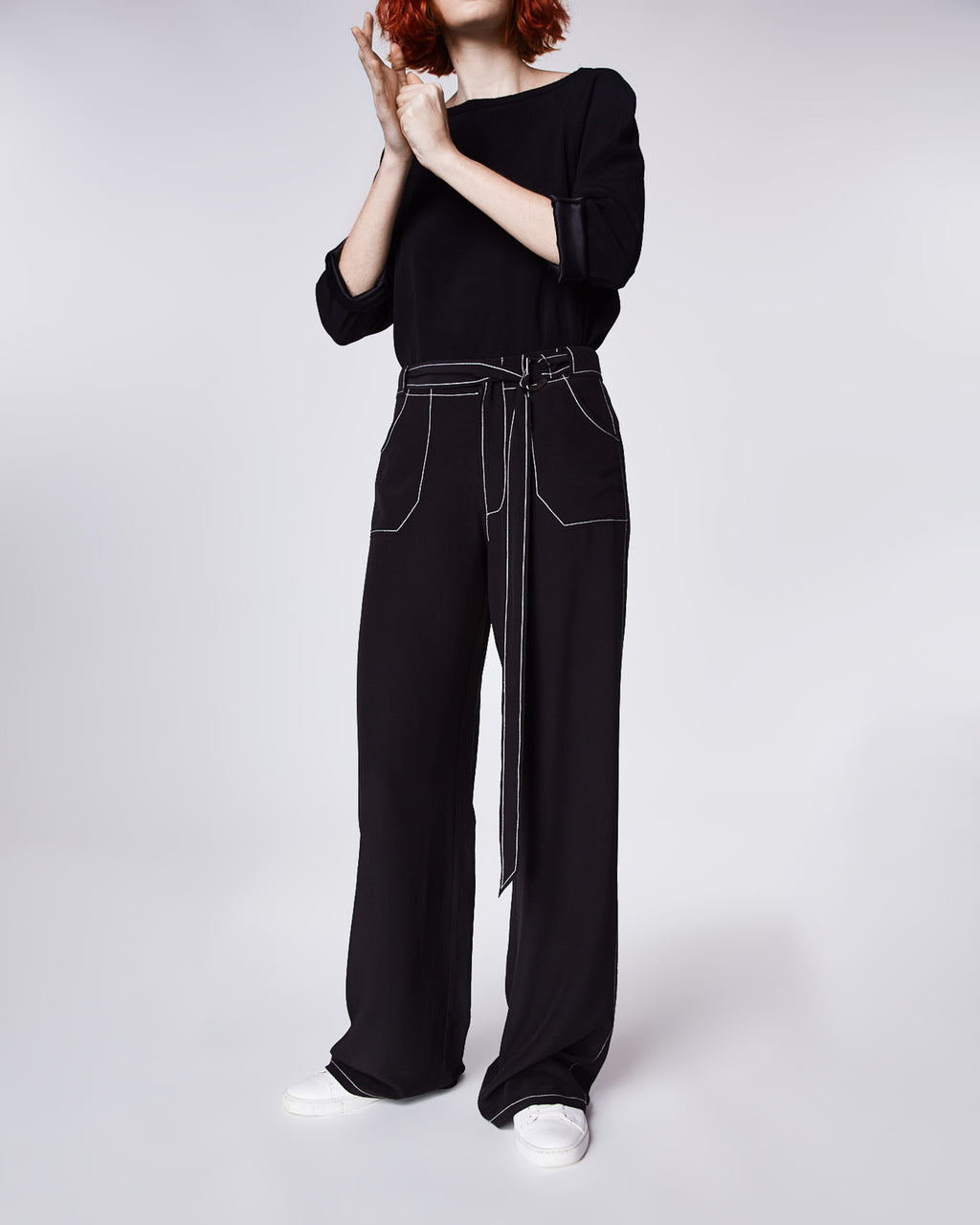 BO10149 - SOLID SILK PANT W/ TOPSTITCH - bottoms - pants - ALL IN THE DETAILS. WITH CONTRASTING WHITE STITCHING, THESE HIGH-WAISTED PANTS FEATURE A WIDE-LEGGED FIT. WEAR WITH BOOTIES OR HEELS TO FINISH THE LOOK. Final Sale