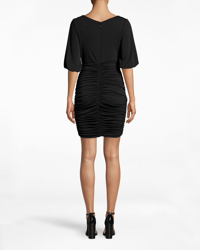 BO10169 - STRETCHY MATTE JERSEY RUCHED DRESS - dresses - short - The draping sleeves on this Stretchy Matte Jersey Dress are an elegant contrast to the ruched skirt. Pair with high heels and take on the evening. Exposed back zipper for closure. Alternate View