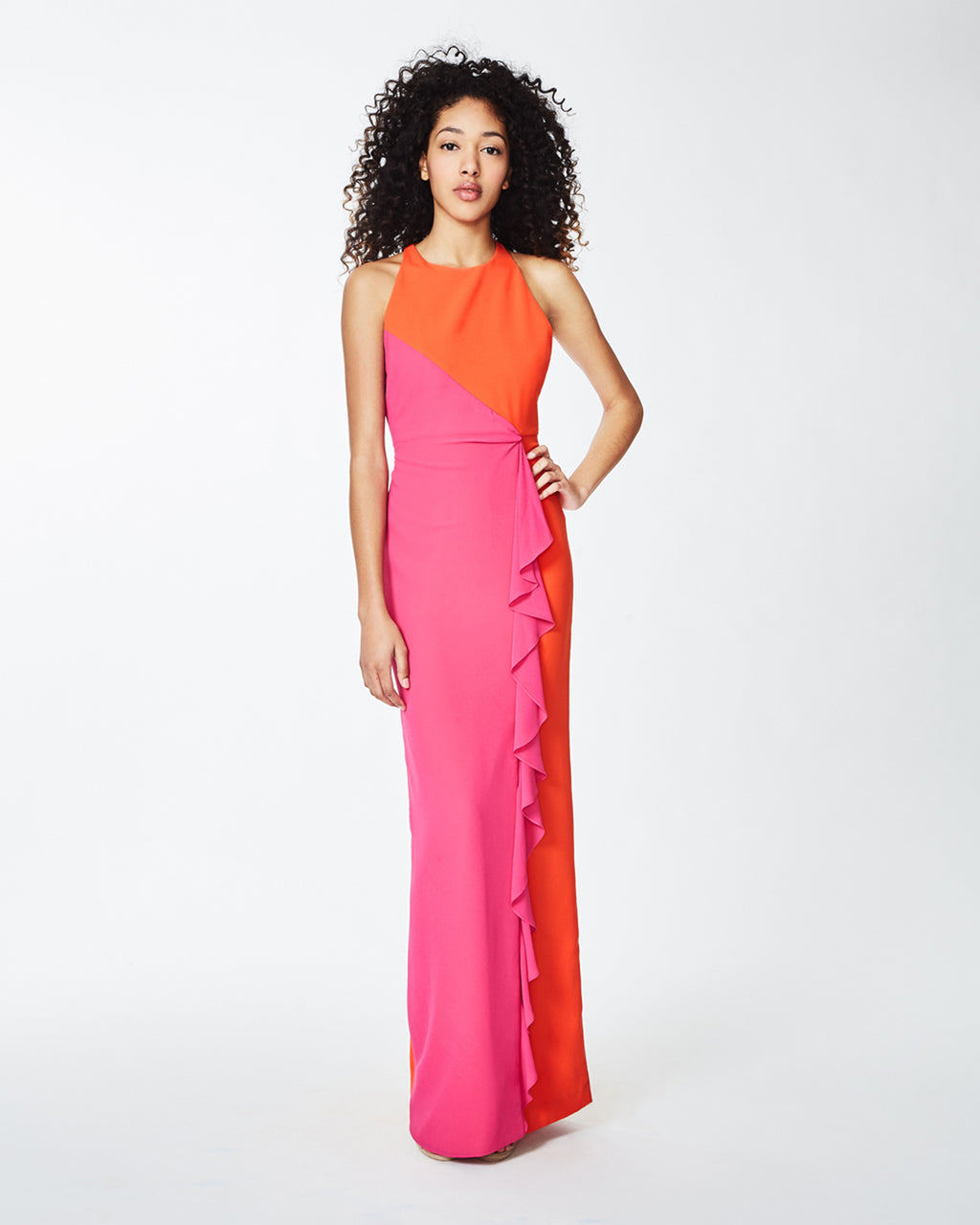 BQ10262 - X-BACK RUFFLE GOWN - dresses - long - Contrasting orange and pink bring a bright and vibrant vibe to this luxe gown. An open, strappy back add a trendy and femme touch to this gown. Finished with a ruffle accent and concealed zipper. Fully lined. Final Sale