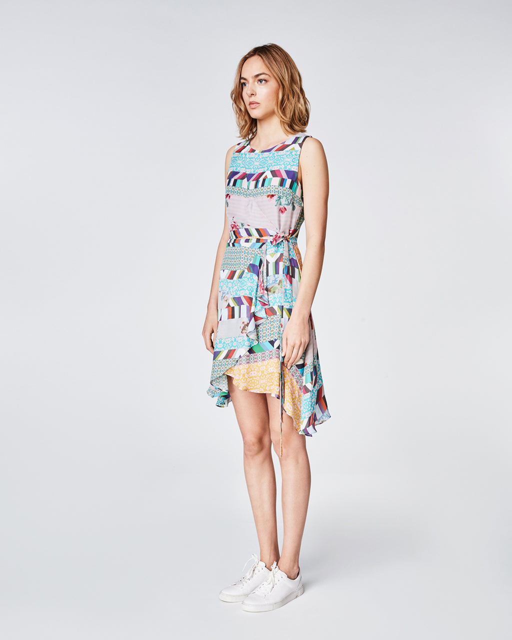 BQ10293 - BOUQUET STRIPE FAUX WRAP DRESS - dresses - short - In a faux wrap silhouette, this silk dress features a contrasting hibiscus print. The delicate ruffles fall to a midi length. Pair with strappy sandals for a completed look. Finished with a concealed zipper, this dress is fully lined. final sale