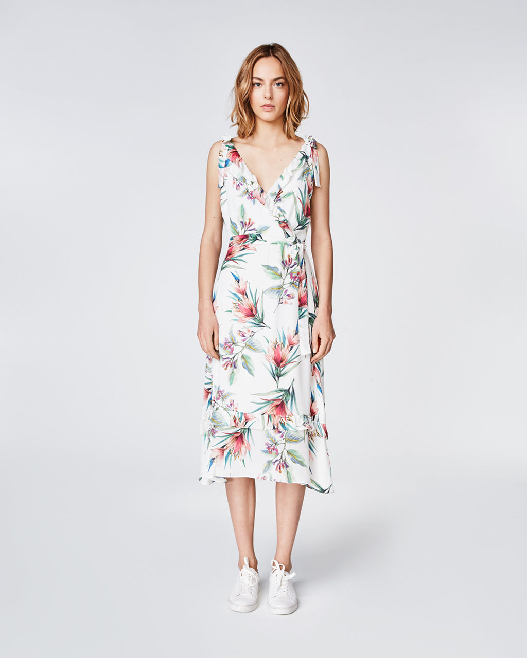 BQ10295 - TROPICALE V NECK DRESS - dresses - midi - With a ruffle v neck and tie waist, this sleeveless dress creates a form flattering silhouette. Falling to a midi length, this dress is crafted in our Tropicale print making it perfect for warmer weather. Finished with a concealed zipper and fully lined. Final Sale
