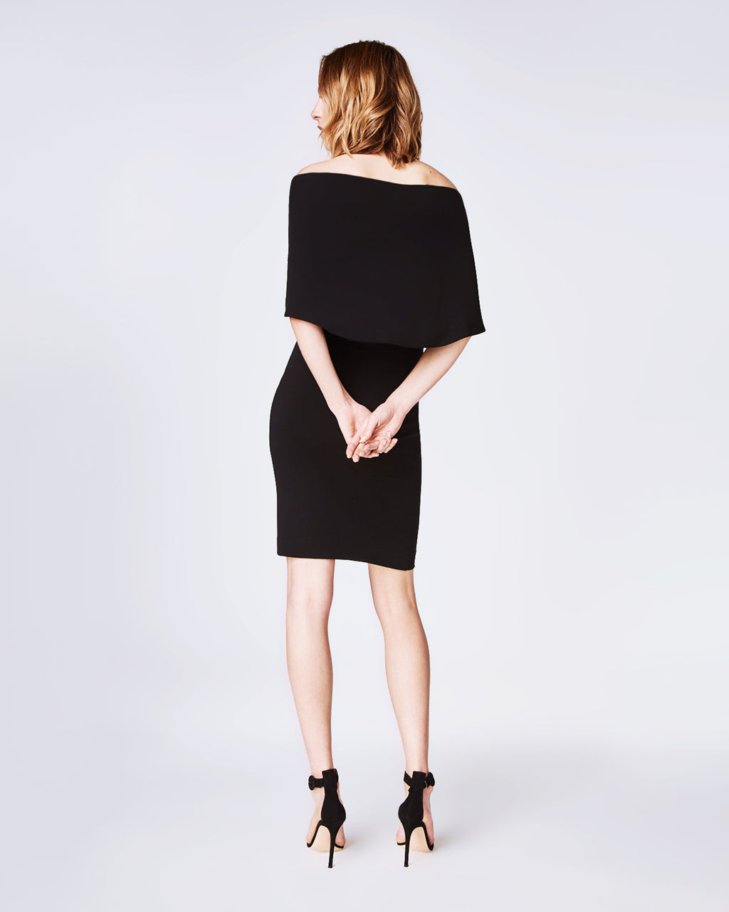 BQ10299 - STRUCTURED HEAVY JERSEY CAPE DRESS - dresses - short - In an off the shoulder silhouette, this little black dress is crafted in a stretchy jersey for a figure hugging fit and falls to a below-the-knee length. Unlined.