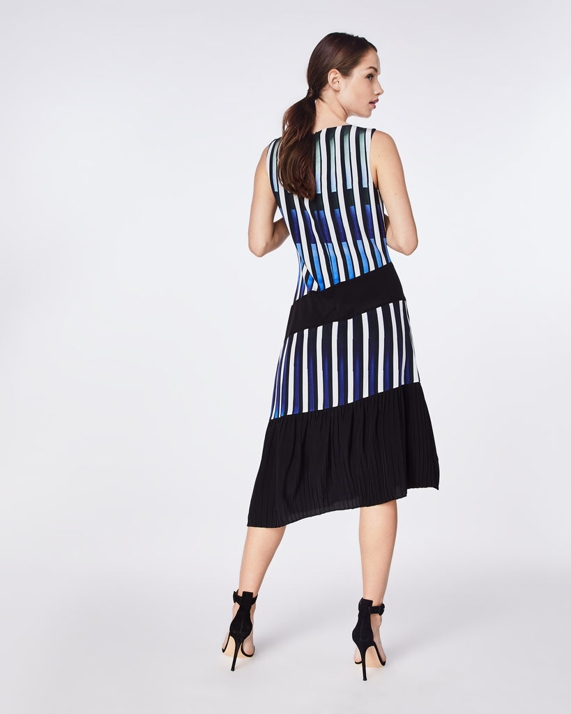 BQ10333 - PIANO KEYS PLEATED DRESS - dresses - midi - Silky and sophisticated, this fit-and-flare dress is elegantly finished with an asymmetrical pleated skirt and fully lined. Throw on a blazer and wear to the office or with black heels for a night out. Alternate View
