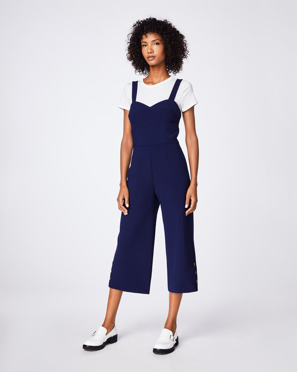 BQ10345 - STRETCHY TECH JUMPSUIT - bottoms - pants - YOUR BOSS JUMPSUIT IS HERE. THIS NAVY, STRETCHY PIECE FEATURES GOLD BUTTONS AT THE LEGS AND A FITTED WAIST. PAIR WITH A T-SHIRT FOR THE AFTERNOON OR WEAR SOLO FOR EVENING. EXPOSED BACK ZIPPER.