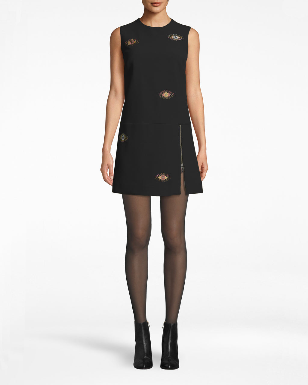 BQ10362 - Evil Eye Embroidered Mini Dress - dresses - short - Eyes on mod. This mini dress is reminiscent of the 60's, with an A-line silhouette and simple neckline. The thigh slit and Evil Eye patches add modern twists. Exposed back zipper for closure.