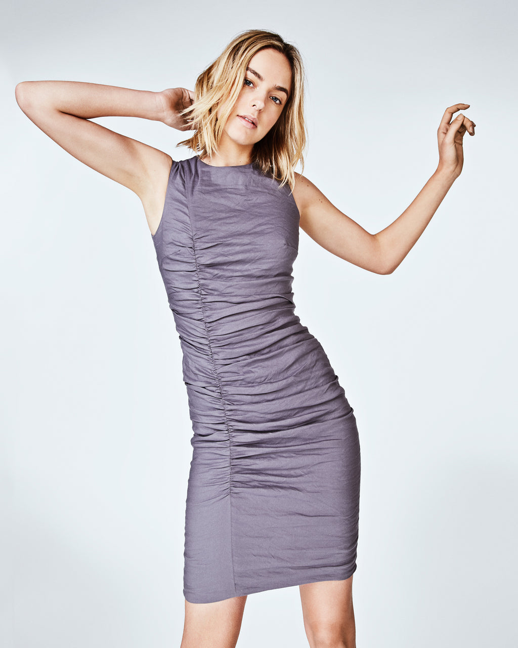BS10162 - SOLID COTTON METAL TUCK DRESS - dresses - short - In our signature cotton metal, this sleeveless dress features a form fitting silhouette. Crafted with mindful tucking, this sheath dress is perfect for the office or a special occasion. Finished with a concealed zipper for closure and a fully lined. lined.